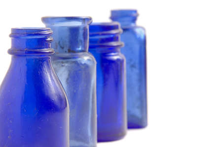 Vintage blue glass bottles isolated on white