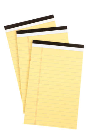 Three pads of lined yellow paper Stock Photo - 22063109