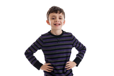 9 year old: Confident 9 year old boy isolated on white