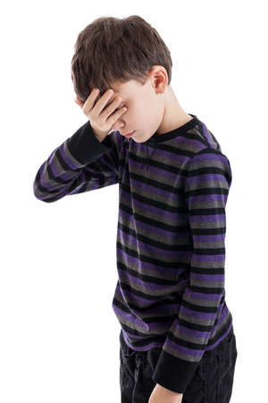 nine years old: Frustrated 9 year old boy isolated on white Stock Photo