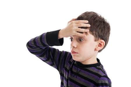 baffled: Forgetful 9 year old boy isolated on white Stock Photo