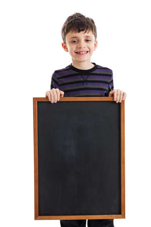 9 year old: 9 year old boy holding blank chalkboard isolated on white
