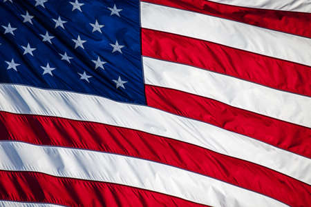 Close up of an American flag blowing in the wind