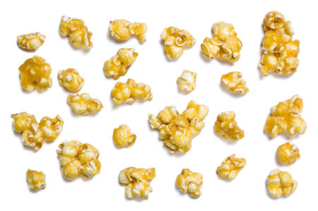 Caramel popcorn pieces isolated on white
