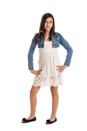 Confident tween girl full length portrait isolated on white photo