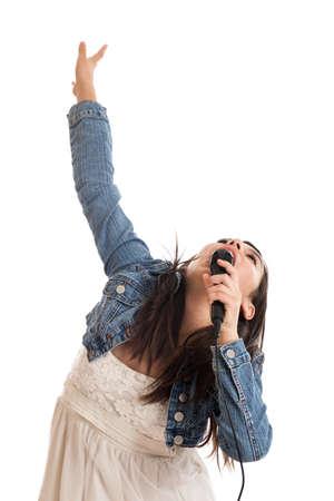 pre adolescence: Tween girl singing karaoke isolated on white