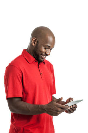 Portrait of a handsome black man in his late 20s looking at tablet pc isolated on white