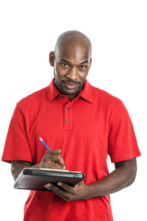 Summer camp director black man in his 20s writing on a clipboard isolated on a white background