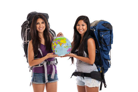 Mixed race young women taking backpack tour isolated on white photo