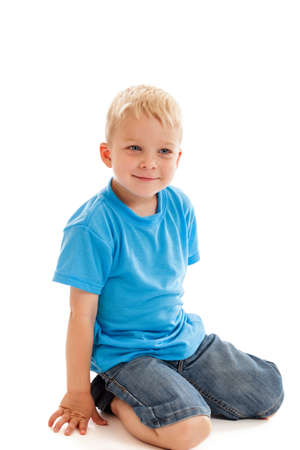 blond boy: 3 year old boy sitting on knees isolated on white