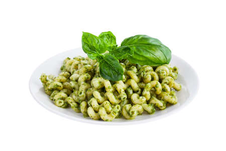 short pasta: Pesto pasta isolated on a white background