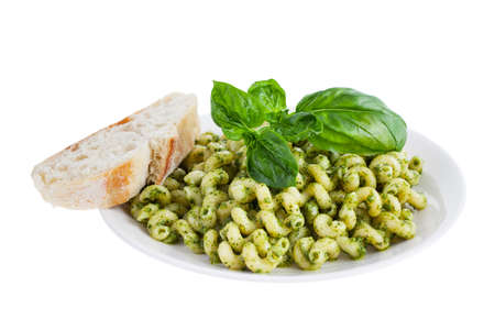 short pasta: Pesto pasta with bread isolated on a white background