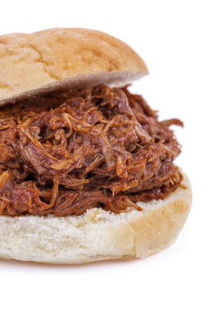 Barbequed pulled pork sandwich isolated on a white background