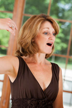 Mature woman taking singing voice lessons
