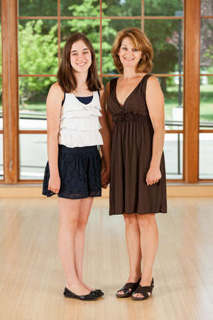 Mother and tween daughter portrait photo