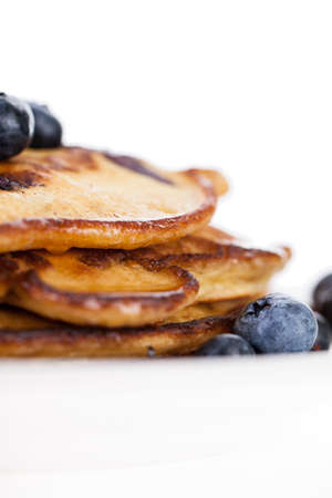 Stack of blueberry pancakes with butter and syrup isolated on a white background Zdjęcie Seryjne