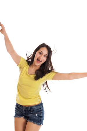 13: Teen girl dancing isolated on a white background Stock Photo