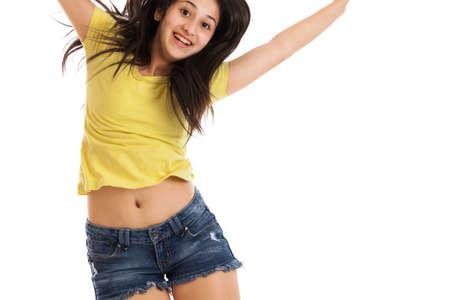 Teen girl jumping portrait isolated on a white background