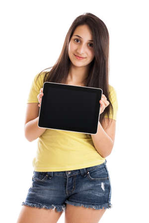 Teen girl holding a blank tablet pc isolated on a white background photo
