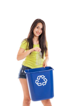 13: Teen girl throwing plastic bottle in a recycling bin isolated on white