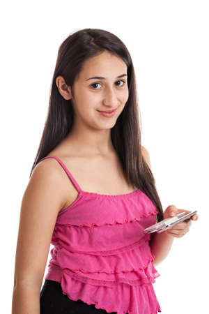 Teen girl texting with cell phone isolated on white photo