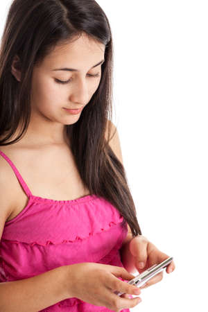 13: Teen girl texting with cell phone isolated on white
