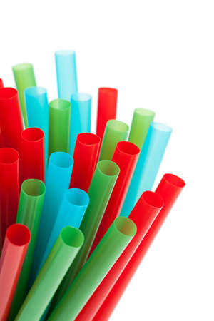 Bunch of colorful extra large drinking straws isolated on a white background photo
