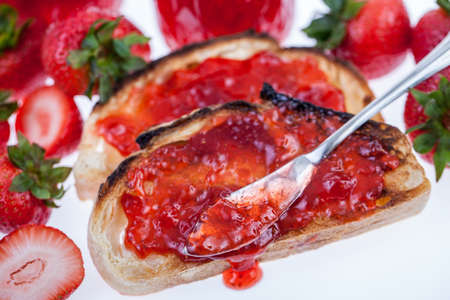 Strawberry jam on slices of toast with strawberries photo