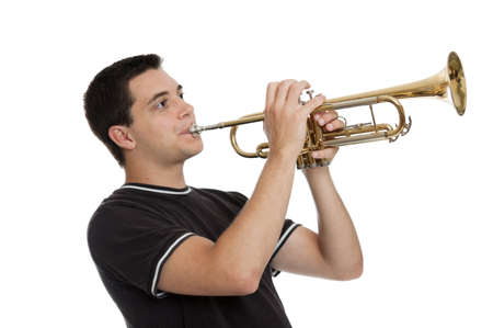 Teen boy playing a trumpet isolated on white