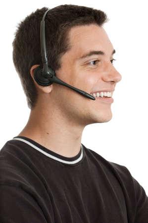 hands free: Ten ni�o hablando en el dispositivo de manos libres aislados en blanco