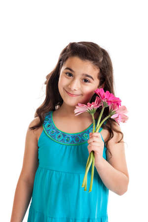 7 year old girl: Cute 7 year old girl holding gerbera daisy flowers isolated on white