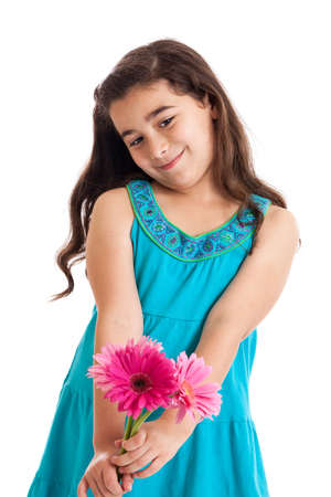 Cute 7 year old girl holding gerbera daisy flowers isolated on white