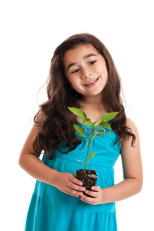 7 year old girl: Cute 7 year old girl holding plant isolated on white Stock Photo