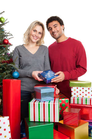 Christmas couple with stack of presents photo