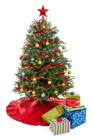 under tree: Small decorated Christmas tree with presents isolated on a white background Stock Photo