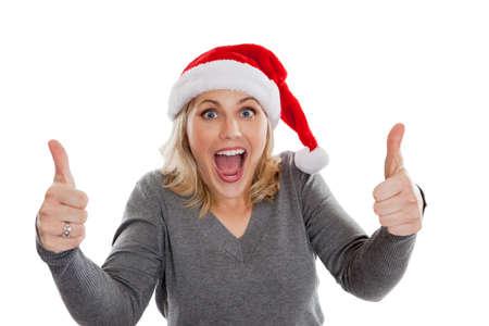wearing santa hat: Happy woman wearing Santa hat with thumbs up