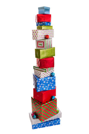 Tall stack of wrapped Christmas gifts isolated on white background Stock Photo