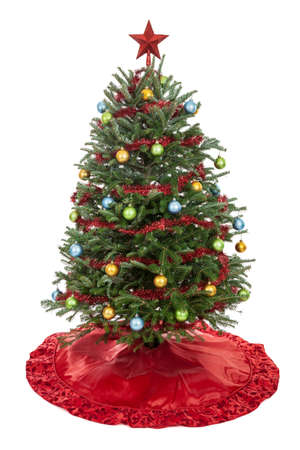 the skirt: Christmas tree with skirt, garland, oranaments and star isolated on white Stock Photo