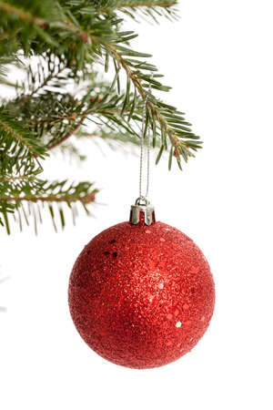 Red Christmas ornament dangling from a Christmas tree branch isolated on white Stock Photo