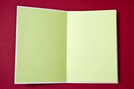 Blank green Christmas card on red background photo