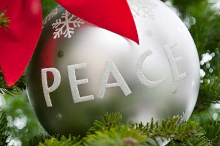 Christmas peace ornament on a real tree Stok Fotoğraf