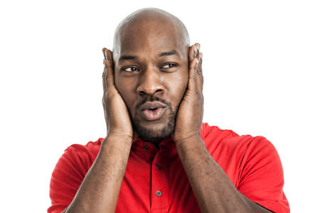 Portrait of a late 20s handsome black man covering ears isolated on white background photo