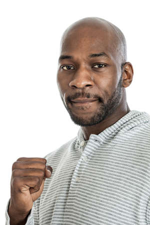 late 20s: Portrait of a late 20s black man looking tough making a fist isolated on a white background