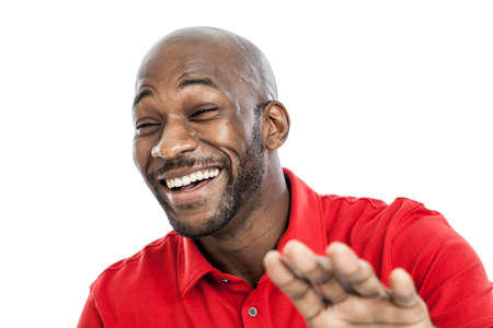 Portrait of a late 20s handsome black man laughing isolated on white background photo