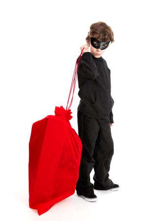 burgler: 8 year old boy stealing Santa s Christmas sack