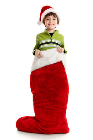 8 year old: 8 year old boy inside a large Christmas stocking