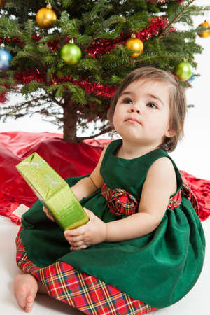 1 year old: Adorable 1 year old girl with Christmas present