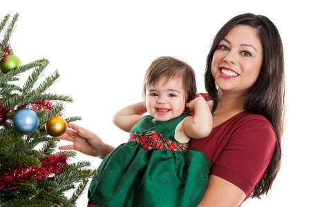 Beautiful mother and daughter at the Christmas tree photo