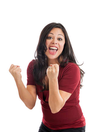 Beautiful Hispanic woman cheering with fist pump