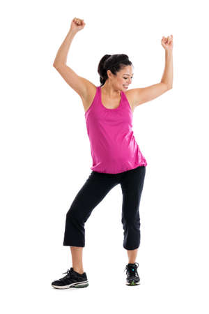 physically fit: Beautiful Hispanic pregnant woman doing low impact aerobic dance